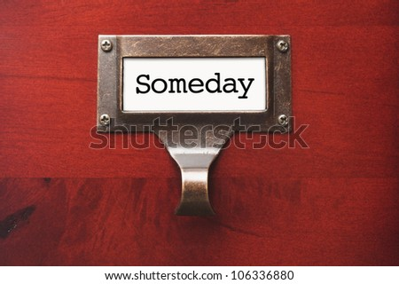 Lustrous Wooden Cabinet with Someday File Label in Dramatic Light. - stock photo