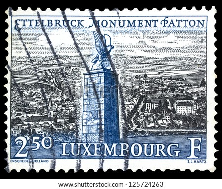 LUXEMBOURG - CIRCA 1961: A stamp printed in Luxembourg, shows General Patton Monument in Ettelbruck with the same inscription and name of series, circa 1961