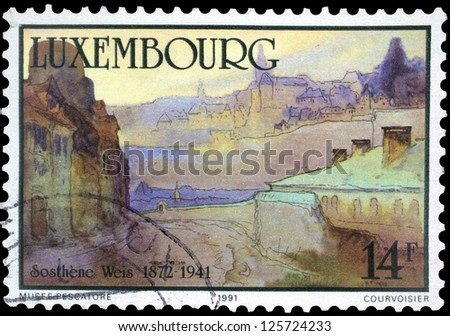 "LUXEMBOURG - CIRCA 1991: A stamp printed in Luxembourg, shows View from the Trier Road with inscription ""Sosthene Weis, 1872 - 1941"", from series ""50th Death Anniversary of Sosthene Weis"", circa 1991"