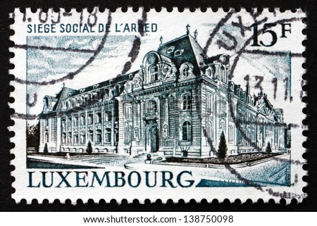 LUXEMBOURG - CIRCA 1971: a stamp printed in the Luxembourg shows ARBED Steel Corporation Headquarters, Luxembourg, circa 1971