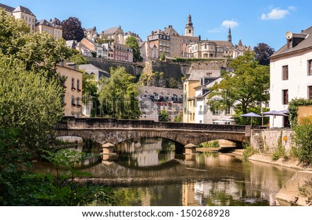 Luxembourg City, downtown city part Grund, scenic view with a bridge across the Alzette river  - stock photo