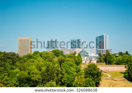 Luxembourg cityscape view from top with many trees in summer