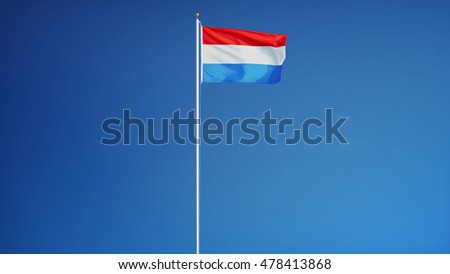 Luxembourg flag waving against clean blue sky, long shot, isolated with clipping path mask alpha channel transparency