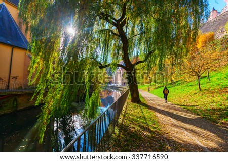 LUXEMBOURG, LUXEMBOURG - NOVEMBER 04, 2015: footpath along river Alzette in the Grund district of Luxembourg with unidentified people. Luxembourg is the capital of same named country and seat of EU