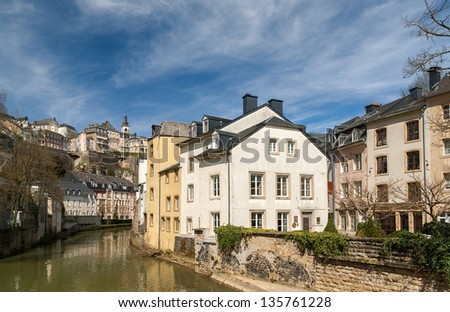 Luxembourg old city: Grund quarter and Alzette river - stock photo