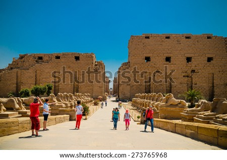 LUXOR, EGYPT - APR 08: Unidentified tourists at  Luxor on 08 Apr 2015, Egypt. This was the largest temple complex of Amun-Re God in ancient Thebes town.