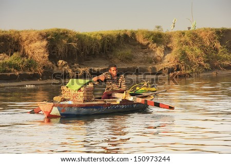 LUXOR, EGYPT - DECEMBER 23: An unidentified man paddles his boat on the Nile river at sunset on December 23, 2010 in Luxor, Egypt. Nile river is generally regarded as the longest river in the world.