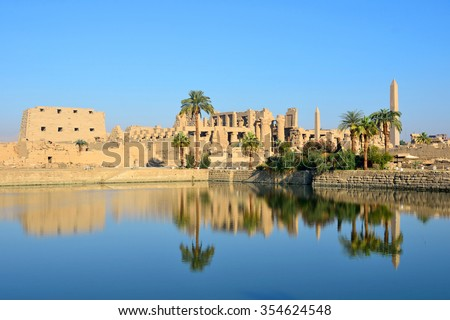 LUXOR, EGYPT - DECEMBER 4 2015: Sacred Lake is in the Karnak Temple complex and it measures 120 meters by 77 meters and was said to be dug by Tuthmosis III in the fifteenth century BC.