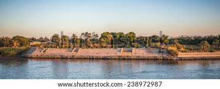 "LUXOR, EGYPT - NOV 30, 2014: Coastline of the river NIle near Luxor. Nile is 6,853 km long. The Nile is an ""international"" river shared by eleven countries"