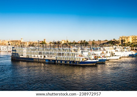 "LUXOR, EGYPT - NOV 30, 2014: Touristic cruiser on the river NIle. Nile is 6,853 km long. The Nile is an ""international"" river shared by eleven countries"