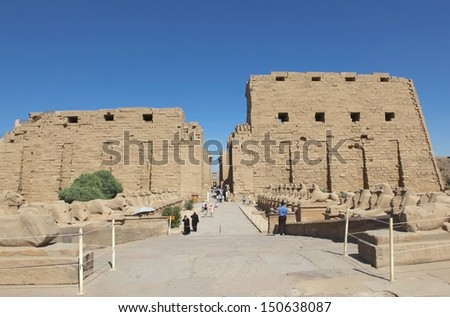 LUXOR, KARNAK, EGYPT - JUNE 19: Tourists going to the temples of Karnak complex on June 19, 2011. in Luxor, Egypt. Tourism is an important item in the Egyptian economy.