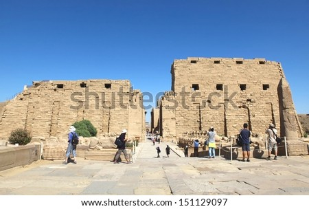 LUXOR, KARNAK, EGYPT - JUNE 19: Tourists take photo at the temples of Karnakt, he largest ancient religious site in the world. June 19, 2011.Tourism is an important item in the Egyptian economy.
