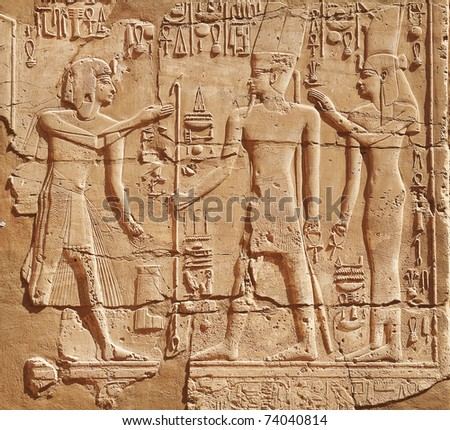 Luxor: stone carvings of the pharaoh and his wife - stock photo