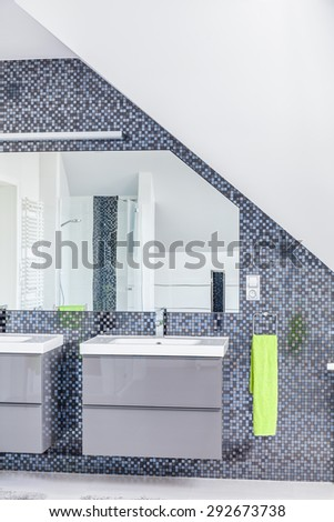 Luxurious bathroom with two sinks and huge mirror