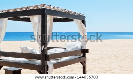 Luxurious bed by the sea, the beach to relax on vacation. Portugal, Algarve. - stock photo