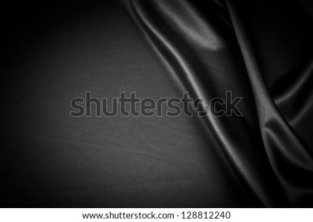 luxurious black satin background close up - stock photo