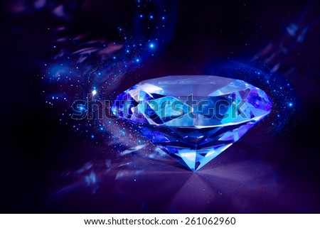 luxurious blue diamond shining on a black background - stock photo