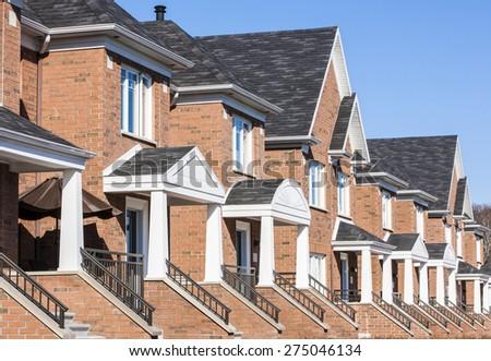 Luxurious brick townhouses. - stock photo