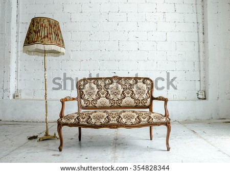 Luxurious classical vintage sofa with desk lamp on white background - stock photo