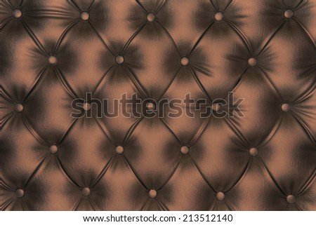 Luxurious dark gold-tone leather texture furniture with buttons - stock photo