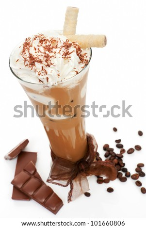 Luxurious delicious iced coffee with foam with chocolate and coffee beans isolated on white. Cool summer drink concept.