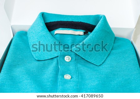 Luxurious fine material 100% cotton polo shirt displayed in gift box. - stock photo