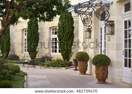 Luxurious garden and facade of a French mansion near Bordeaux