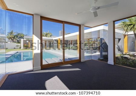 Luxurious home interior and exterior in new empty mansion - stock photo