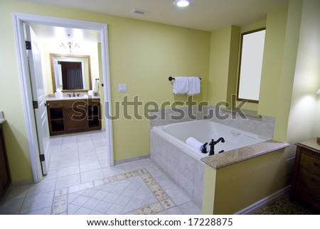 luxurious hotel bathroom with large jacuzzi tub