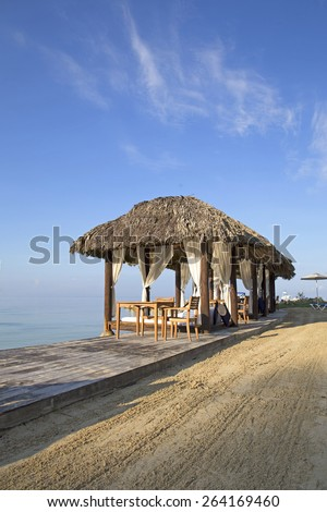 luxurious king size beds by the caribbean sea - stock photo