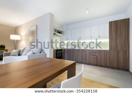 Luxurious kitchen with living area in background - stock photo