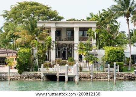 Luxurious mansion by the seaside on Star Island, Miami, home of the rich and famous - stock photo