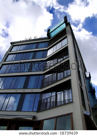 luxurious modern city centre flats with roof pool photographed at an odd abstract angle - stock photo