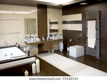 luxurious modern white bathroom with dark wood floors - stock photo