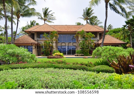 Luxurious ocean side estate home on Kaanapali Beach in West Maui. - stock photo