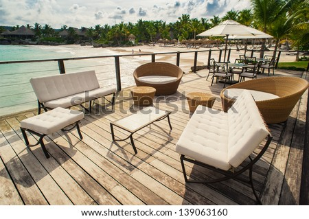 luxurious open-air restaurant on the banks of the beautiful beach. Summer vacation on a luxury Caribbean resort in the Dominican Republic. Outdoor restaurant. Cafe on the beach, ocean and sky.