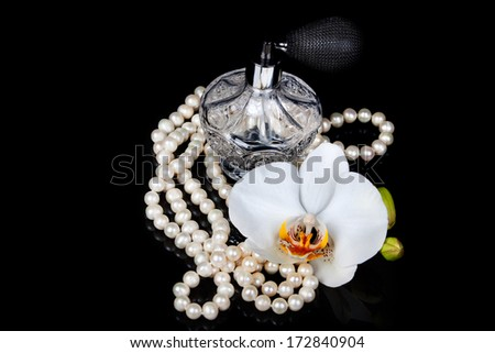 Luxurious perfume bottle atomizer with flower blossom - stock photo