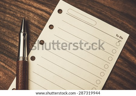Luxurious rollerball pen and empty to do list  - stock photo