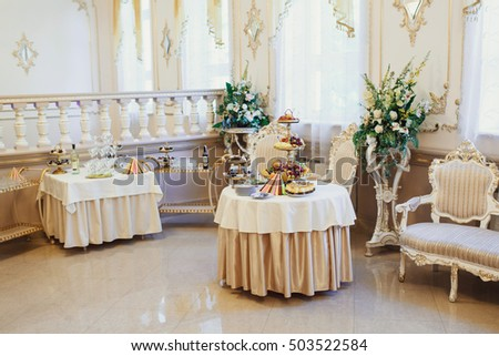 luxurious room with tables for buffets