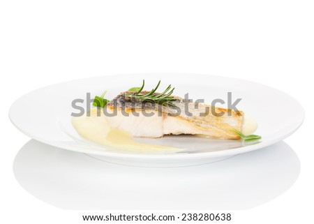 Luxurious seafood dinner and delicious fish eating. Fresh perch fish fillet with sauce on white plate isolated on white. Exquisite eating, fine gastronomy. - stock photo