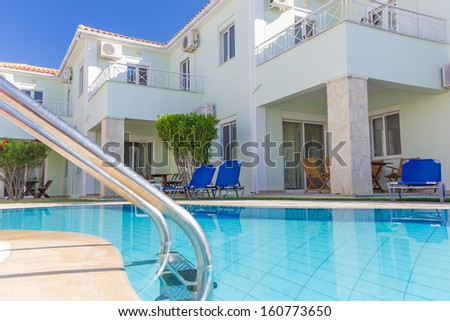 Luxurious villas complex resort with pool in Greece - stock photo