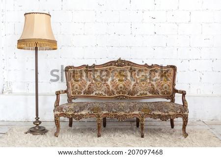 Luxurious Vintage Style Sofa and Lantern - stock photo