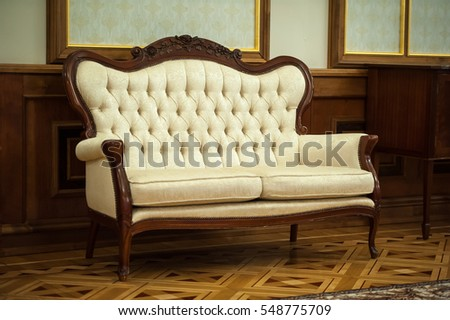 Luxurious White And Golden Sofa. Texture Furniture With Fabric Upholstery  And Buttons. Sofa Background