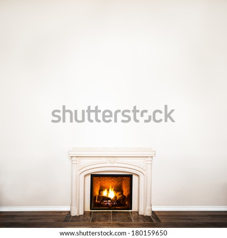 Luxurious White Marble Fireplace and empty wall for your text, logo, images, etc - stock photo