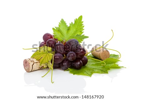 Luxurious wine still life. Red wine grapes and wine corks isolated on white background with reflection. Culinary wine drinking, minimal style. - stock photo
