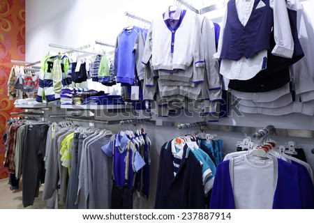 luxury and fashionable brand new interior of kids cloth store - stock photo