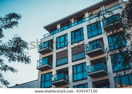 luxury apartment house with clear blue balcony - stock photo