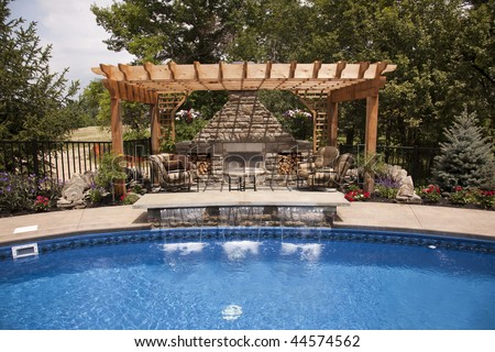Luxury backyard with a pool - stock photo