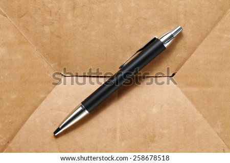 Luxury ball pen put on the old paper texture surface background represent the writing equipment related.