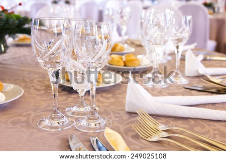 Luxury banquet table setting with crystal glasses. - stock photo
